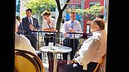 Group of lawyers enjoying coffee on the outside patio of Coffee Exchange in 2019 in Windsor, Ontario.