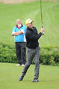 Alan Pardew tees off during the Julian Speroni Testimonial Golf Day at the Surrey National Golf Club, Chaldon, United Kingdom on 9 September 2015. Photo by Michael Hulf.