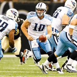 September 1, 2011; New Orleans, LA, USA; Tennessee Titans quarterback Jake Locker (10) hands off to running back Kestahn Moore (38) during the first quarter of a preseason game against the New Orleans Saints at the Louisiana Superdome. Mandatory Credit: Derick E. Hingle