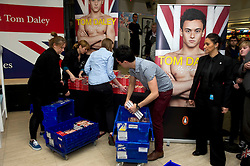 © Licensed to London News Pictures. 21/04/2011 London, UK..Staff unload Olympic diving hopeful Tom Daley's book, 'My Story' before a book signing event on his eighteenth birthday at Waterstone's. Piccadilly. London. Photo credit : Simon Jacobs/LNP