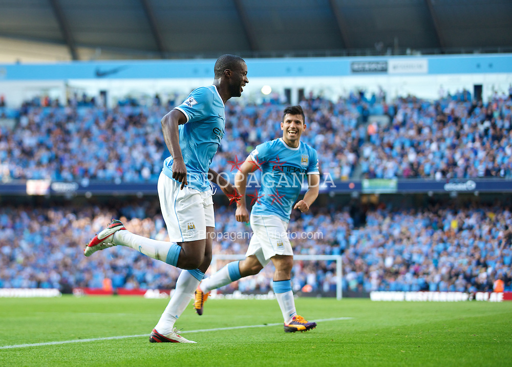 MANCHESTER, ENGLAND - Sunday, September 22, 2013: Manchester City's Yaya Toure celebrates scoring the second goal against in added time of the first half against Manchester United during the Premiership match at the City of Manchester Stadium. (Pic by David Rawcliffe/Propaganda)