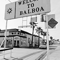 Photo of the Welcome to Balboa sign for the Balboa Island Auto Ferry in Newport Beach California. The Balboa Island Ferry has been operating since 1919 and carries people and cars from Balboa Peninsula to Balboa Island across Newport Harbor (Newport Bay). Newport Beach is located along the Pacific Ocean in Orange County California in the United States.