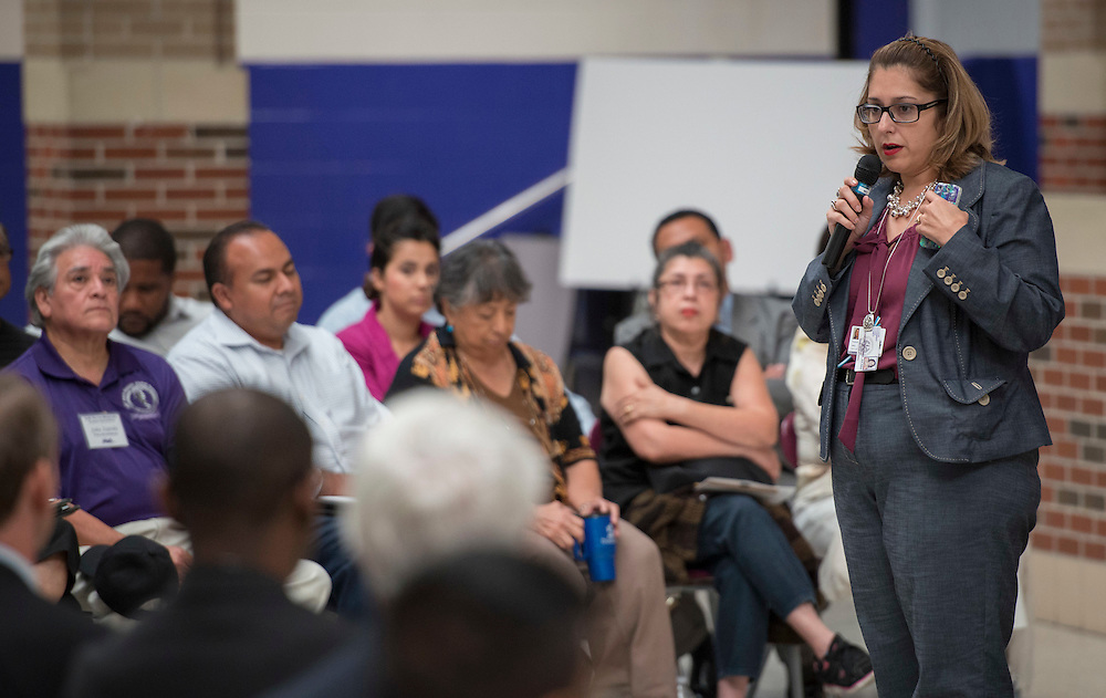 Julissa Alcantar Martinez talks with community members, parents and students during the first 2012 Bond community meeting at Davis High School, July 15, 2014.