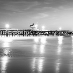 San Clemente California pier black and white panorama picture. San Clemente is a popular beach city in Orange County California in the United States of America. Panorama photo ratio is 1:3.  Copyright ⓒ 2017 Paul Velgos with all rights reserved.