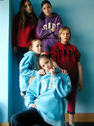 Group of girls wearing Gap jumpers