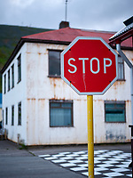 Stop sign and house. Siglufjörður, North Iceland.