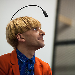 London, UK - 27 February 2014: Neil Harbisson speaks at Cybersalon in London. Neil Harbisson is a British-born artist and he became, in 2004, the first person in the world to wear an eyeborg. The inclusion of the eyeborg on his passport photo has been claimed by some to be official recognition of Harbisson as a cyborg.