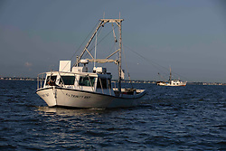 Texas Parks & Wildlife Coastal Fisheries Trawling boat, The Trinity Bay, in Galveston Bay on Texas Gulf Coast.