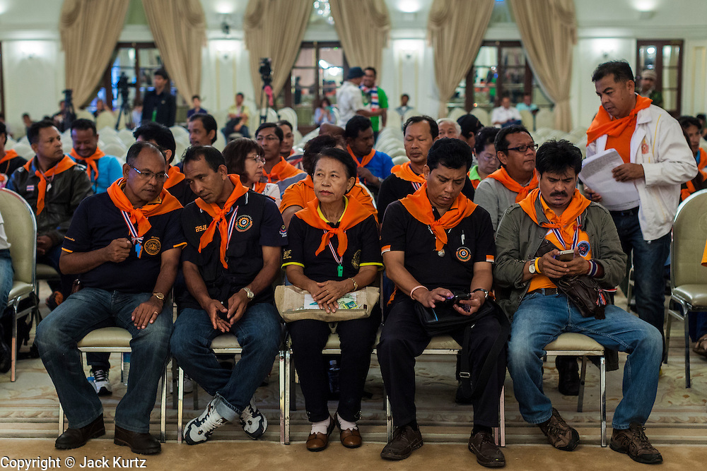 18 MAY 2014 - BANGKOK, THAILAND: Representatives of state enterprises wait for Suthep Thaugsuban at Government House in Bangkok. Suthep them to a meeting at his office in Government House, normally the office of the Prime Minister, to make assignments for the coming week. Suthep has pledged to overthrow the government of interim caretaker Prime Minister Niwatthamrong Boonsongphaisan, a member of former Prime Minister Yingluck Shinawatra's inner circle. Niwatthamrong became PM after the courts ousted Yingluck. Suthep has pledged to remove the Shinawatra family from Thai politics by May 27 or he will turn himself into police to face prosecution.      PHOTO BY JACK KURTZ