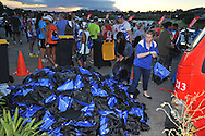 BELLVILLE, SOUTH AFRICA - Wednesday 3 December 2014, Runners prize bags during the Metropolitan 10km road race outside the Parc Du Cap head office in Bellville.<br /> Photo by IMAGE SA / Roger Sedres