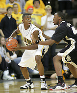 26 NOVEMBER 2007: Iowa guard Justin Johnson (24) tries to get around Wake Forest guard L.D. Williams (42) in Wake Forest's 56-47 win over Iowa at Carver-Hawkeye Arena in Iowa City, Iowa on November 26, 2007.