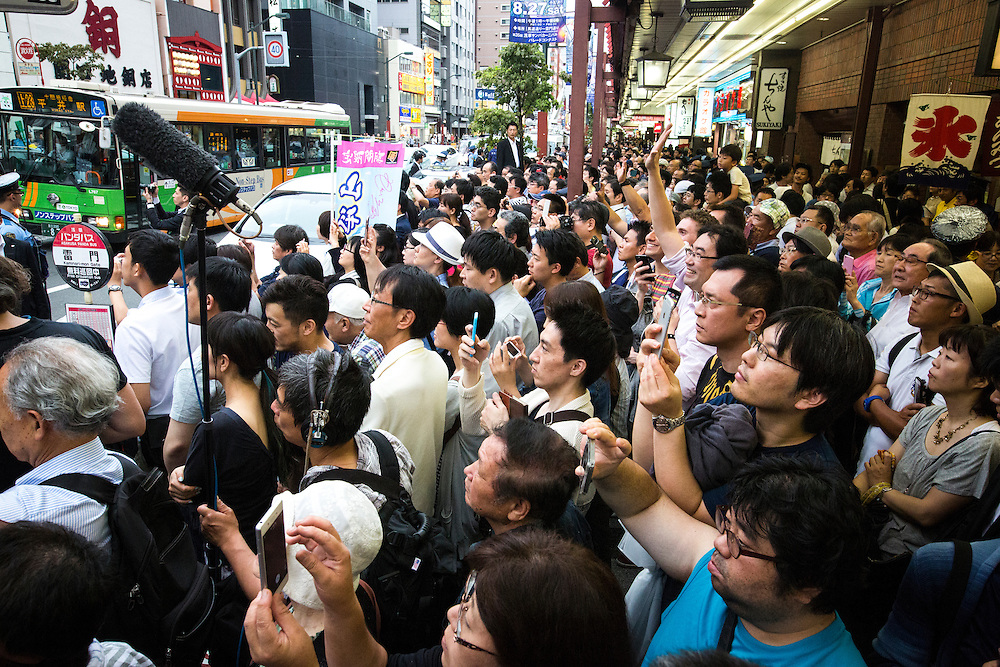 TOKYO, JAPAN - JULY 9 :  Supporters of ruling Liberal Democratic Party (LDP) watch Prime Minister Shinzo Abe delivers a campaign speech during the last day of Upper House election campaign outside of Asakusa Station in Tokyo, Japan on July 9, 2016. Tomorrow, July 10, 2016 will be the first Upper house election nation-wide in Japan that 18 years old can vote after government law changes its voting age from 20 years old to 18 years old. (Photo by Richard Atrero de Guzman/NURPhoto)