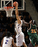 Kansas State center Jason Bennett (55) drives past Cleveland State's J'nathan Bullock (35) for a dunk in the first half at Bramlage Coliseum in Manhattan, Kansas, December 5, 2006.  K-State leads the Vikings 50-23 at halftime.<br />
