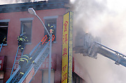 fireman entering a house on fire
