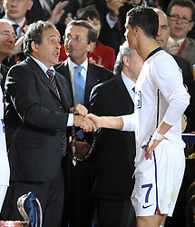Michel Platini and Cristiano Ronaldo shake hands after the final of the UEFA football Champions League on May 27, 2009 at the Olympic Stadium in Rome.