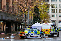 © Licensed to London News Pictures. 06/12/2019. London, UK. A tent stands in Hans Crescent where the body of what is believed to be a man in his 20s has been found with stab wounds outside Harrods in knightsbridge, London around 1am this morning. Police teams are on the scene. Photo credit: Alex Lentati/LNP