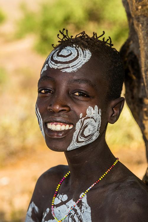 Kara tribe boy with chalk body painting, Omo Valley, Ethiopia.