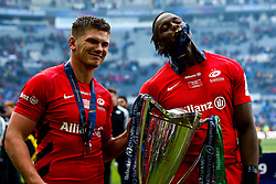 Owen Farrell and Maro Itoje of Saracens celebrate winning the Heineken Champions Cup after beating Leinster Rugby in the Final - Mandatory by-line: Robbie Stephenson/JMP - 11/05/2019 - RUGBY - St James' Park - Newcastle, England - Leinster Rugby v Saracens - Heineken Champions Cup Final