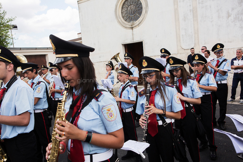 GRASSANO, ITALY - 24 JULY 2014: The marching band of Grassano plays at the end of the ceremony to celebrate the arrival of Mayor of New York Bill de Blasio in Grassano, his ancestral home town in Italy, on July 24th 2014.<br /> <br /> New York City Mayor Bill de Blasio arrived in Italy with his family Sunday morning for an 8-day summer vacation that includes meetings with government officials and sightseeing in his ancestral homeland.