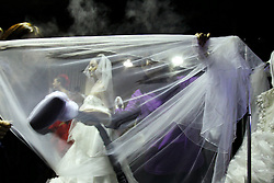 A stylist steam irons a veil as models prepare backstage before the fashion show by Chinese label Famory Wedding collection during the China Fashion Week in Beijing, China, 28 October 2012. The Mercedes-Benz China Fashion Week will run from 24 October to 3 November.
