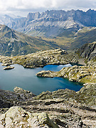 "Lac Cornu is a good day hike in the Reserve Naturelle Aiguilles Rouges, on the Chamonix-Zermatt Haute Route (High Route) near Chamonix, France, Europe. Published in Ryder-Walker Alpine Adventures 2006 ""Inn to Inn Alpine Hiking Adventures"" Catalog."