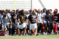 21 August 2008: Football players in street school clothes walk onto the playing field before the USC Trojans Pac-10 NCAA College football team final intrasquad scrimmage of fall camp in front of 8,000 fans in the Los Angeles Memorial Coliseum near school campus.  White team (1st and 2nd teamers) defeated the Cardinal (reserves) team 28-7 on Thursday.