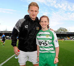 Yeovil Town's Byron Webster has his photo taken with a young Yeovil Town mascot - Photo mandatory by-line: Dougie Allward/JMP - Tel: Mobile: 07966 386802 10/11/2013 - SPORT - FOOTBALL - Huish Park - Yeovil - Yeovil Town v Wigan Athletic - Sky Bet Championship