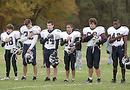 Cornwall-on-Hudson, New York - Harvey School football players place their hands over their hearts during the playing of the national anthem before a high school football game on Oct. 17, 2009.