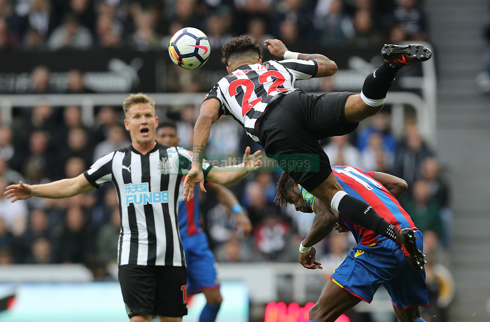 Newcastle United's DeAndre Yedlin and Crystal Palace's Wilfried Zaha battle for the ball during the Premier League match at St James' Park, Newcastle.