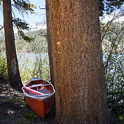 A canoe sits on the shore of Lake Mary in Mammoth Lakes.