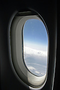 The view through a commercial jet window in flight