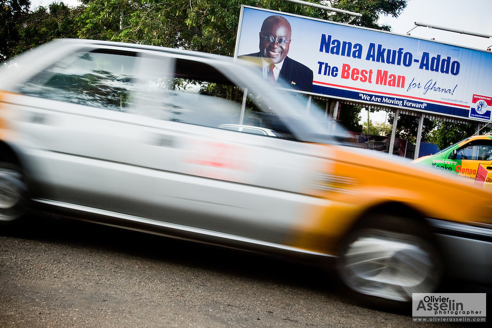 A taxi drives past a billboard promoting New Patriotic Party (NPP) candidate Nana Akufo-Addo ahead of the upcoming presidential elections in Accra, Ghana on Monday September 8, 2008.