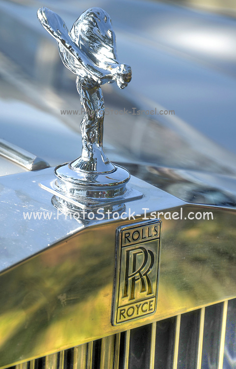 Vintage Rolls Royce car. Close up on the emblem and logo