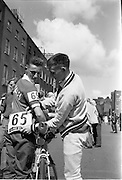 "05/08/1962<br /> 08/05/1962<br /> 05 August 1962 <br /> Start of An Rás Tailtean from the G.P.O. Dublin. ""Helping hand"". J. O'Mahony of the Cork Team helps his team mate P. Reidy with his number before the start of Ras Tailteann at the G.P.O. Dublin."