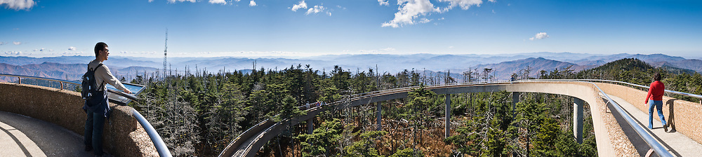 "A spiral ramp leads to a popular observation tower on Clingman's Dome, with a panoramic view of Great Smoky Mountains National Park of Tennessee and North Carolina, in southeastern USA. Clingmans Dome (6,643 feet or 2,025 meters elevation) is the highest mountain in the Great Smokies, the highest in Tennessee, the highest along the 2,174-mile (3,499 km) Appalachian Trail, and the third-highest mountain in the Appalachian range. A paved road connects it to U.S. Highway 441 (Newfound Gap Road). The summit is coated by a Spruce-fir (or ""boreal"") forest, common in northern latitudes, but found only in the highest elevations in the southeastern United States. Clingmans Dome, like most of the Great Smokies, consists of a type of lightly metamorphosed sedimentary rock (especially sandstone) that is part of the Ocoee Supergroup formation, created from ancient ocean sediments nearly one billion years ago. The Smoky Mountains are among the oldest in the world, lifted approximately 200-300 million years ago in the Alleghenian orogeny. Panorama stitched from 6 overlapping photos."