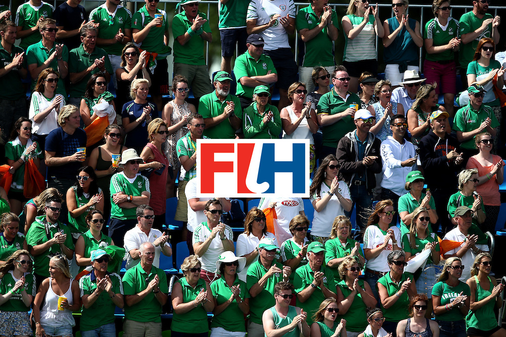 RIO DE JANEIRO, BRAZIL - AUGUST 11:  Ireland fans cheer against Canada during a Men's Preliminary Pool B match on Day 6 of the Rio 2016 Olympics at the Olympic Hockey Centre on August 11, 2016 in Rio de Janeiro, Brazil.  (Photo by Sean M. Haffey/Getty Images)