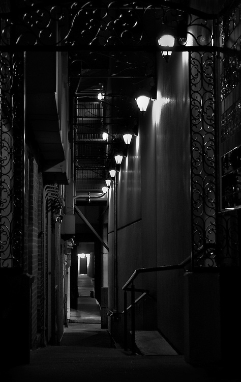 A passageway between buildings in the Plaza, Kansas City, Missouri Photography by Kirk Decker