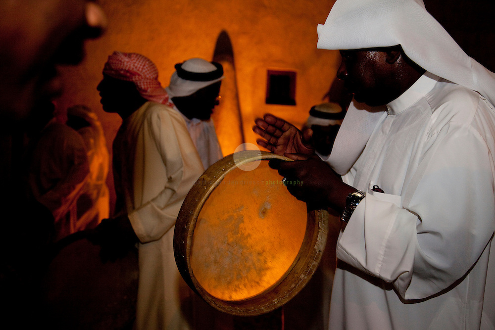 traditional beduin music and folklore: ASIA, UNITED ARAB EMIRATES, DUBAI, 21.03.2009. for an exhibition opening attended by the ruler of Dubai, Sheikh Mohammed Bin Rashid Al Maktoum, a group of men demonstrates local dances and music. For the past 40 years, Dubai has been transformed rapidly - from a desert village to an international center for finance and tourism. With locals making up now less than 20% of the population, many efforts are taken to remind about the UAE's beduin history.