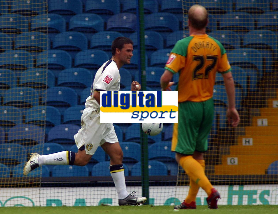 Photo: Paul Thomas.<br /> Leeds United v Norwich City. Coca Cola Championship.<br /> 05/08/2006.<br /> <br /> David Healy (L) of Leeds scores from the penalty spot as Gary Doherty looks on.