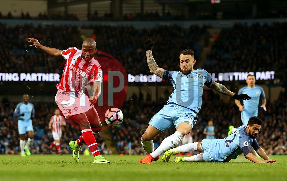 Nicolas Otamendi of Manchester City blocks a shot from Saido Berahino of Stoke City - Mandatory by-line: Matt McNulty/JMP - 08/03/2017 - FOOTBALL - Etihad Stadium - Manchester, England - Manchester City v Stoke City - Premier League