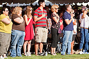 30 MAY 2011 - PHOENIX, AZ: People stand with their hands over their hearts during the presentation of the colors during Memorial Day services in the National Memorial Cemetery in Phoenix, AZ, Monday. Memorial Day was celebrated with services across the United States Monday.    Photo by Jack Kurtz