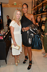 Left to right, ALISON HENRY and SHERRETT DAHLSTROM at a lunch hosted by Alice Naylor-Leyland and Tamara Beckwith in celebration of the Coach 2015 collection held at Coach, New Bond Street, London on 18th September 2014.