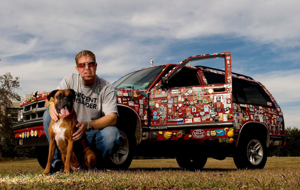 04 Jan, 2006. New Orleans, Louisiana.  Post Katrina aftermath.<br /> Magnet man Chris Cressionnie and his dog Mika with his 1994 Chevy Blazer. Chris traversed New Orleans after the hurricane collecting fridge magnets from all the discarded fridges left abandoned and stinking in the streets. He now has a collection of thousands of magnets and residents continue to donate magnets as do people from all across the USA.<br /> Photo; &copy;Charlie Varley/varleypix.com