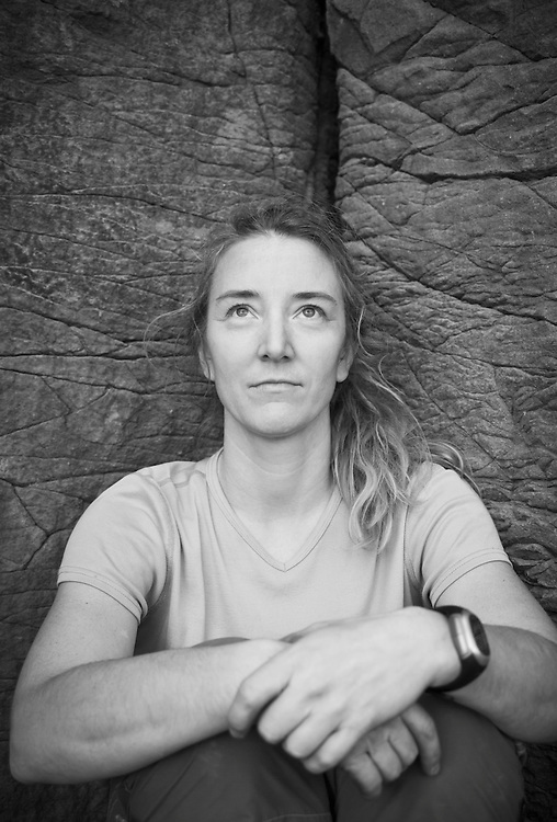 Portrait of a middle aged woman outside in front of a rock wall, Vantage, Washington, USA.