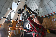 OHIO Mechanical System Technician Doug Shafer prepares the telescope for operation at it's new home in the Ridges. © Ohio University/ Photo by Ben Siegel