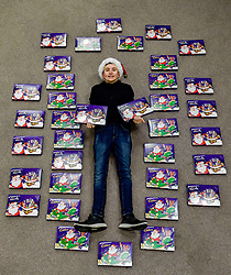 Pictured: Jack Valentine with some of the selection boxes.<br /> <br /> Paisley schoolboy Jack Valentine (15) used his pocket money and wages from a paper round to buy over a hundred selection boxes to donate to the Glasgow South West food bank for children who's parents depend on the food bank this Chrsitmas.<br /> <br /> © Dave Johnston / EEm