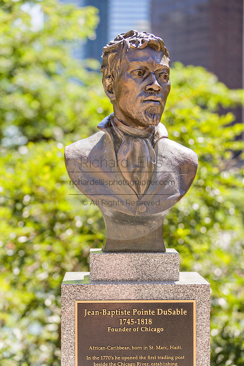 Bronze bust of Jean Baptiste Pointe DuSable Bridge at Pioneer Court in Chicago, Illinois, USA. DuSable is known as the founder of Chicago.