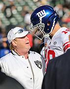Dec 3, 2017; Oakland, CA, USA; Oakland Raiders managing general partner Mark Davis talks with New York Giants quarterback Eli Manning (10) prior an NFL game between the New York Giants and the Oakland Raiders at Oakland-Alameda County Coliseum.