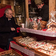 BUDAPEST, HUNGARY - DECEMBER 07:  A man buys some traditional Hungarian sweets at the  Vorosmarty Square Christmas market on December 7, 2017 in Budapest, Hungary. The traditional Christmas market and lights will stay until 31st December 2017.