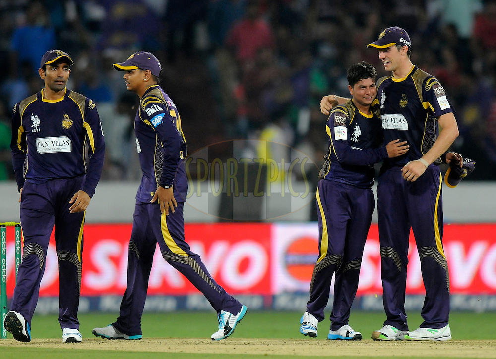 Kuldeep Yadav of Kolkata Knight Riders celebrates the wicket of Mohammad Hafeez Captain of Lahore Lions during match 7 of the Oppo Champions League Twenty20 between the Kolkata Knight Riders and the Lahore Lions held at the Rajiv Gandhi Cricket Stadium, Hyderabad, India on the 21st September 2014<br /> <br /> Photo by:  Pal Pillai / Sportzpics/ CLT20<br /> <br /> <br /> Image use is subject to the terms and conditions as laid out by the BCCI/ CLT20.  The terms and conditions can be downloaded here:<br /> <br /> http://sportzpics.photoshelter.com/gallery/CLT20-Image-Terms-and-Conditions-2014/G0000IfNJn535VPU/C0000QhhKadWcjYs